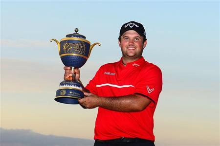Mar 9, 2014; Miami, FL, USA; Patrick Reed celebrates with the trophy after winning the WGC - Cadillac Championship golf tournament at TPC Blue Monster at Trump National Doral. Mandatory Credit: Andrew