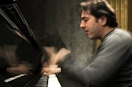 Acclaimed Turkish pianist and composer Fazil Say plays in 2010 at the Theatre des Champs-Elysees in Paris, prior to a concert. Say faces trial in October on charges of insulting religious values, with a possible 18-month prison sentence