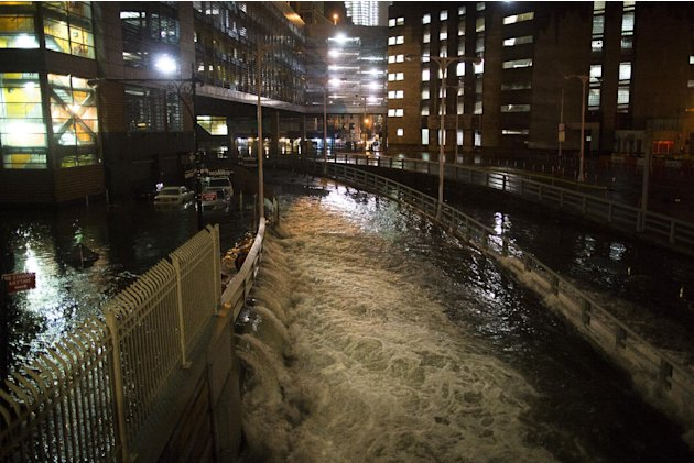 Sea water floods the entrance to the Brooklyn Battery Tunnel, Monday, Oct. 29, 2012, in New York. Sandy continued on its path Monday, as the storm forced the shutdown of mass transit, schools and fina