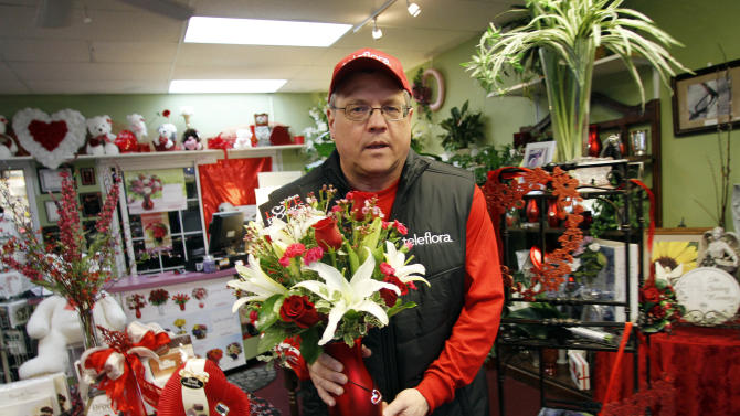 Send Your Love Florist owner, Andy Jackson carries Teleflora's  Romantic Heartstrings Bouquet at his shop in Greensboro, N.C., Wednesday, Jan. 30, 2013. Teleflora's 'Love Rocks' sweepstakes launched on January 21 and runs until 10 p.m. (PST) February 10.  During the span of the sweeps, each time a customer places an order for a romantic Heartstrings Bouquet from teleflora.com, they will be automatically entered to win one of nine heart-shaped diamond necklaces valued at $15,000. Teleflora will select three lucky winners of a show-stopping diamond necklace every week leading up to Valentine's Day.  Get your orders in by Sunday night for the weekly Monday drawings starting January 28 with additional drawings on February 4 and February 11.  Orders placed early increase the odds of winning the lottery. (Jim R. Bounds/AP Images for Teleflora)