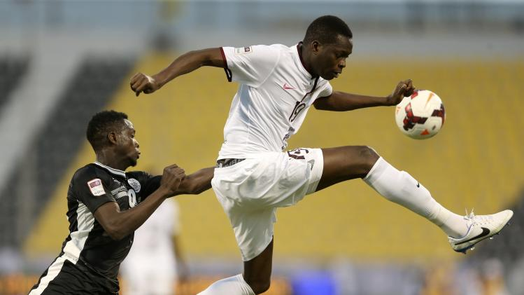 Al-Sadd's Yusef Ahmed fights for the ball with El-Jaish's Abdurahman Abker during the Qatar Cup semi-final soccer match in Doha