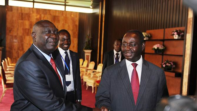 Central African Republic President Francois Bozize, right, shakes hands with Michel Djotodia, leader of the Seleka rebel alliance, during peace talks in Libreville, Gabon, Friday, Jan. 11, 2013. Officials say that the rebel group controlling much of the northern half of the country have agreed to enter into a coalition with the government. The deal will allow President Francois Bozize to stay in office until his current term expires in 2016.(AP Photo/Joel Bouopda Tatou)