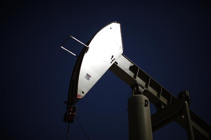 Oil eases on glut, production outlook