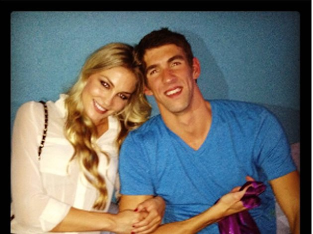 Megan Rossee tweets this image of herself and Michael Phelps with the caption, &#39;Yay Michael :)&#39;