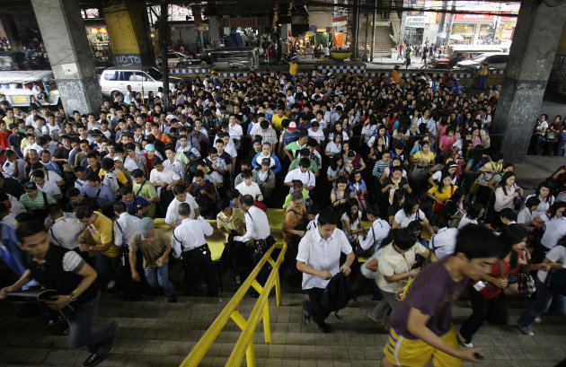 Filipino commuters crowd the Light Rail Transit, LRT, station during the morning rush hour in suburban Caloocan City, north of Manila, Philippines, Monday, Sept. 19, 2011 as many find alternate means