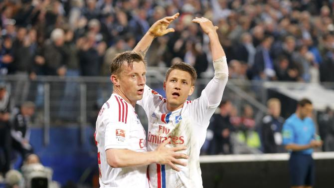 Hamburger SV's Ilicevic celebrates with Olic after scoring against Karlsruhe SC during their German Bundesliga first leg relegation playoff soccer match in Hamburg