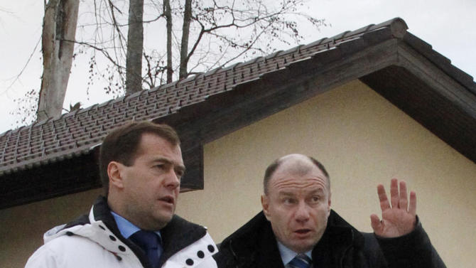 FILE - In this Tuesday, Jan. 4, 2011 file photo, then Russian President Dmitry Medvedev, left, accompanied by Interros Investment Company President Vladimir Potanin visits the Roza Khutorski resort that is under construction for the 2014 Sochi Winter Olympics, near the Black Sea resort of Sochi, southern Russia. Metals tycoon Vladimir Potanin, whose fortune is an estimated US dlrs 14.3 billion, started building the Roza Khutor ski resort before Sochi was picked to hold the Olympics. Infrastructure required by the International Olympic Committee costing US dlrs 500 million boosted his total bill to US dlrs 2.5 billion. (AP Photo/Mikhail Metzel, File)