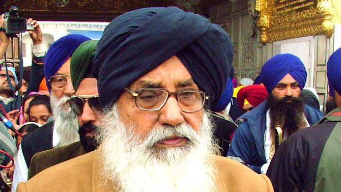 FILE - In this March 3, 2007, file photo, Parkash Singh Badal, chief minister of the Indian state of Punjab, pays obeisance at the Golden Temple in Amritsar, India. Badal is expected to visit Wisconsin for a July 5, 2013, wedding and a Sikh group accusing him of human-rights violations is offering $10,000 to anyone who serves him with a federal summons while he's here. (AP Photo/Deepak Sharma, File)