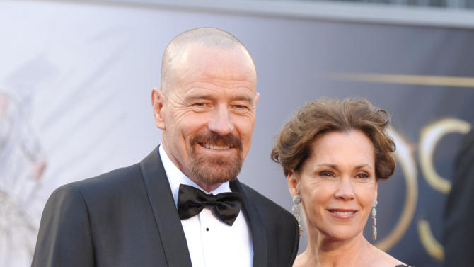 Actor Bryan Cranston, left, and wife Robin Dearden arrive at the Oscars at the Dolby Theatre on Sunday Feb. 24, 2013, in Los Angeles. (Photo by John Shearer/Invision/AP)