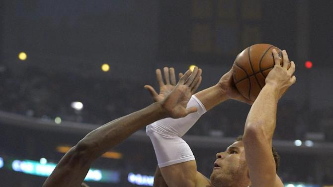 Los Angeles Clippers forward Blake Griffin, right, puts up a shot as tforward Serge Ibaka, of Congo, defends during the first half of their NBA basketball game, Tuesday, Jan. 22, 2013, in Los Angeles.  (AP Photo/Mark J. Terrill)