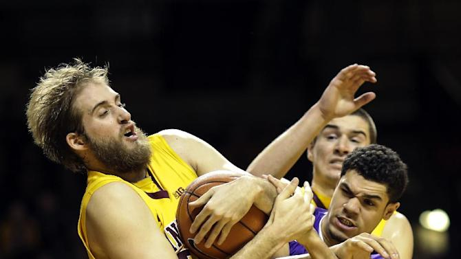 Minnesota's Elliot Eliason, left, grabs the ball from Furman's Kris Acox during an NCAA college basketball game in Minneapolis, Monday, Dec. 22, 2014. (AP Photo/The Star Tribune, Renee Jones Schneider)  MANDATORY CREDIT; ST. PAUL PIONEER PRESS OUT; MAGS OUT; TWIN CITIES TV OUT