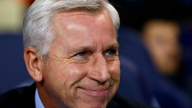 Newcastle United's manager Alan Pardew smiles before their English League Cup quarter-final soccer match against Tottenham Hotspur at White Hart Lane in London