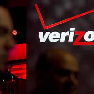 Verizon Jumps and Home Depot Slumps as Dow Winners and Losers