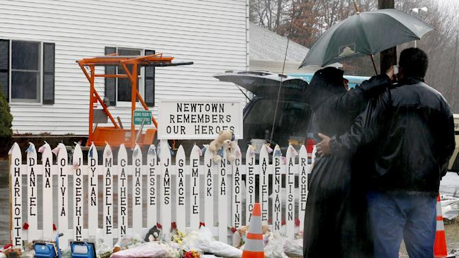 """CHASE KOWALSKI, 7: Chase was always outside, playing in the backyard, riding his bicycle. A week earlier, he was visiting neighbor Kevin Grimes, telling him about completing — and winning — his first mini-triathlon. """"You couldn't think of a better child,"""" Grimes said. ---- Names of Connecticut school shooting victims, including Chase, are displayed on a makeshift memorial as people walk by on Friday, Dec. 21, 2012, in Newtown, Conn.  (AP Photo/Julio Cortez)"""