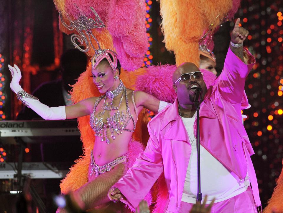 "Cee Lo Green performs with the Jubilee! showgirls during the Caesars Entertainment ""Escape To Total Rewards"" concert in Los Angeles, Thursday, March 1, 2012. Simultaneous concert events were held in New York, Chicago, New Orleans and Los Angeles. (AP Photo/Chris Pizzello)"
