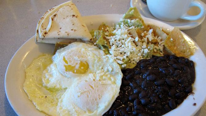 In this Sept. 14, 2014 photo, a plate of Chilaquiles is displayed at Harry's Roadhouse, in Santa Fe, N.M., a diner that is a favorite among locals. (AP Photo/Jeri Clausing)