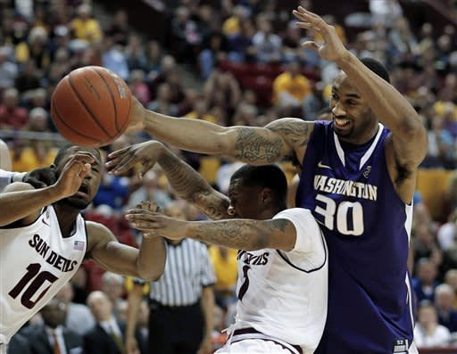 Suggs leads Huskies to 68-59 win over Sun Devils