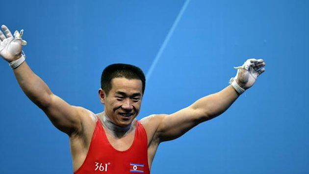 UNITED KINGDOM, London : North Korea's Om Yun Chol celebrates after competing during the weightlifting men's 56kg group B at the Excel Center in London during the 2012 London Olympic Games on July 29, 2012. AFP PHOTO / YURI CORTEZ