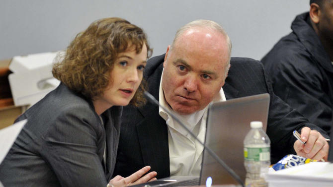 FILE - In a Friday, April 26, 2013 file photo, Michael Skakel, right, talks to Jessica Santos, one of his defense attorneys, during his appeal at State Superior Court in Vernon, Conn. On Wednesday, Oct. 23, 2013, Skakel's conviction in the death of Moxley was set aside and new trial ordered by a Connecticut judge, Thomas Bishop, who ruled that Sherman failed to adequately represent him when he was found guilty in 2002. Skakel's current attorney, Hubert Santos, said he expects to file a motion for bail on Thursday. If a judge approves it, Skakel could then post bond and be released from prison. (AP Photo/The Stamford Advocate, Jason Rearick, Pool, File)