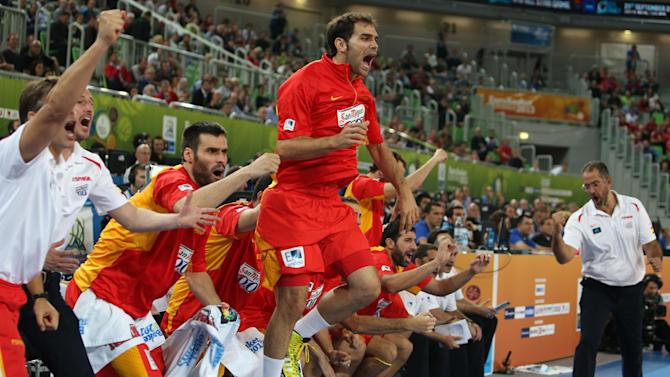 Spain's team celebrate a two-point shot against Serbia during their EuroBasket European Basketball Championship quarterfinal match at the Stozice Arena, in Ljubljana, Slovenia, Wednesday, Sept. 18, 2013. (AP Photo/Thanassis Stavrakis)