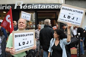 "People hold signs reading ""Dissolution of the …"