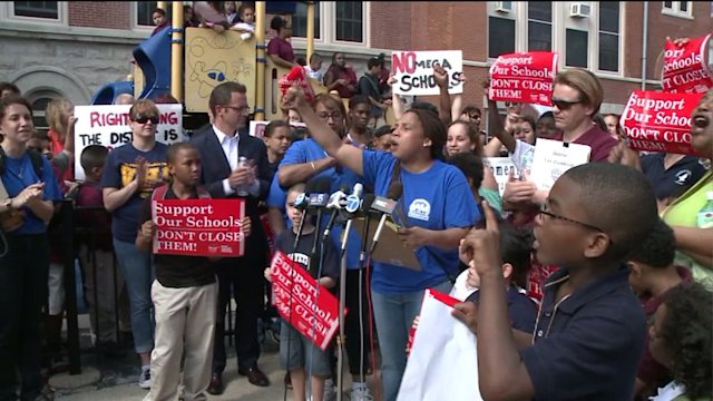 Crowds rally as CPS closure vote looms
