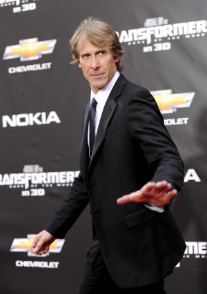 """FILE - In this June 28, 2011 file photo, Executive producer and director Michael Bay attends the """"Transformers: Dark Of The Moon"""" premiere in Times Square in New York. Bay incited outrage among many fans of the franchise when he announced at the Nickelodeon upfront presentation last week that the crime-fighting turtles would come from an """"alien race"""" in a """"Ninja Turtles"""" film he is producing. (AP Photo/Evan Agostini, file)"""