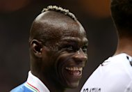 Mario Balotelli celebrates his two goals which fired Italy into the Euro 2012 final