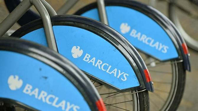 Bicylces for hire, sponsored by Barclays, are lined up in a rack in London October 30, 2013. REUTERS/Toby Melville/Files