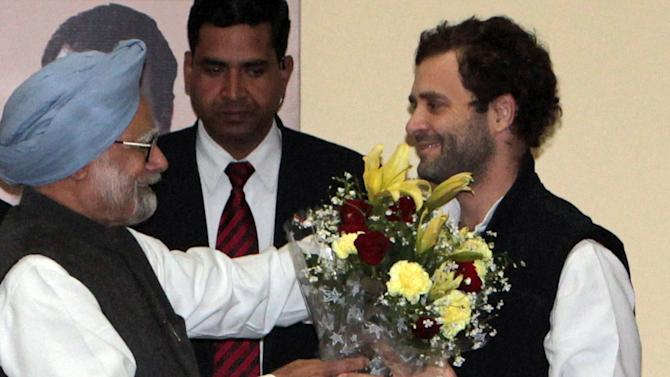 Indian Prime Minister Manmohan Singh, left, greets Rahul Gandhi after he was appointed Vice President of the Congress party, in Jaipur, India, Saturday, Jan. 19, 2013. Gandhi, the scion of India's Nehru-Gandhi political dynasty, was on Saturday elevated to the governing Congress party's No. 2 post, positioning him to lead the party that his family has long dominated in parliamentary elections next year. (AP Photo)