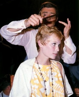 VIdal Sassoon cutting Mia Farrow's hair on the set of Rosemary's Baby