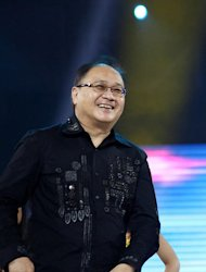 TV5 owner Manny V. Pangilinan seen onstage during the Wil Time Bigtime Sama-sama sa Unang Taon, the TV show's first year anniversary celebration held at Smart Araneta Coliseum in Quezon City, northeast of Manila. (Marlo Cueto/NPPA Images)
