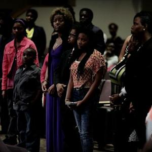 Supporters pack Ferguson church in rally for fatally shot teen