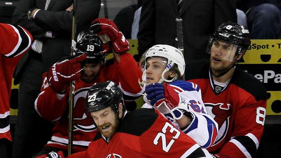 David Clarkson #23 Of The New Jersey Devils Checks Carl Hagelin #62 Of The New York Rangers In Game Three Of The Getty Images