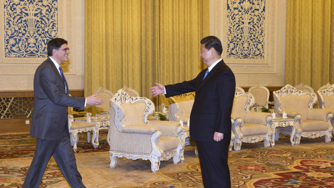 U.S. Treasury Secretary Jacob Lew, left, prepares to shake hands with Chinese President Xi Jinping during their meeting at the Great Hall of the People in Beijing Tuesday, March 19, 2013. Xi said Beijing wants strong ties with Washington as he held talks with the Lew on Tuesday in his first meeting with a foreign official since being appointed president. (AP Photo/Andy Wong, Pool)