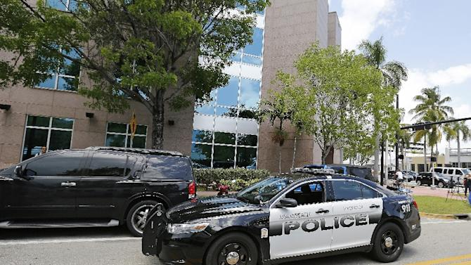 A Miami Beach police car sits outside the headquarters of CONCACAF after it was raided by FBI agents on May 27, 2015