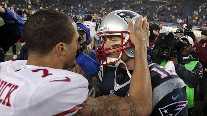 San Francisco 49ers quarterback Colin Kaepernick (7) and New England Patriots quarterback Tom Brady (12) meet at midfield after their NFL football game in Foxborough, Mass., Monday, Dec. 17, 2012. The 49ers won 41-34. (AP Photo/Steven Senne)