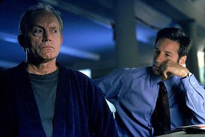 "Former FBI agent Frank Black (Lance Henriksen, L) is called in to help Agents Mulder (David Duchovny, R) and Scully investigate a series of bizarre murders linked to the Millennium Group in the ""Millennium"" episode of Fox's The X-Files X-Files"