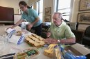 """In this Aug. 1, 2013 photo, 85-year-old Don Tenbrunsel, right, and Alex Wissman, soup kitchen volunteers, work at making lunches at St. Josaphat's Church in Chicago. Tenbrunsel is a """"super ager,"""" participating in a Northwestern University study of people in their 80s and 90s with astounding memories. So far the research has found scientific evidence that brains in this elite group resemble those of people decades younger. (AP Photo/M. Spencer Green)"""