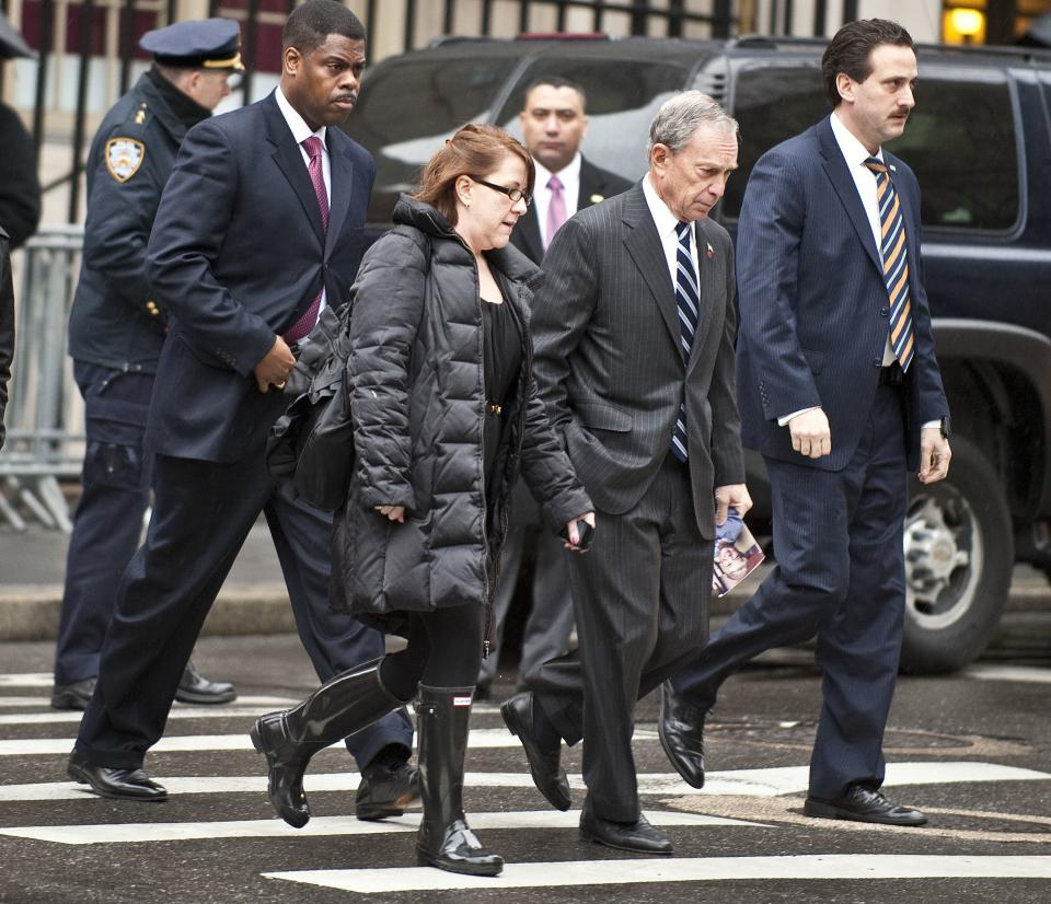 New York City Mayor Michael Bloomberg, center, arrives for the funeral mass for former vice presidential candidate Geraldine Ferraro, Thursday, March 31, 2011 in New York. (AP Photo/Stephen Chernin)