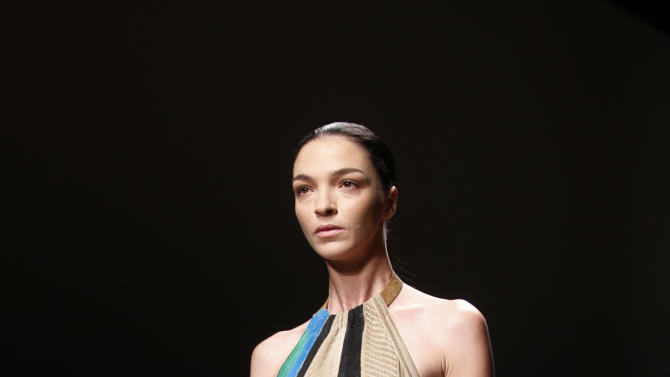 A model wears a creation for Ferragamo women's spring-summer 2015 collection, part of the Milan Fashion Week, unveiled in Milan, Italy, Sunday, Sept. 21, 2014. (AP Photo/Luca Bruno)