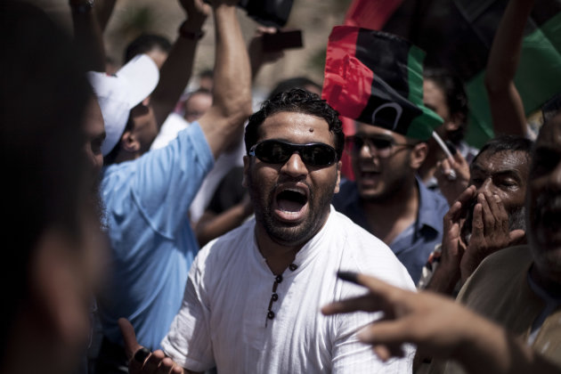 A Libya man chants revolutionary slogans while celebrating on election day in Martyrs&#39; Square in Tripoli, Libya, Saturday, July 7, 2012. Jubilant Libyan voters marked a major step toward democracy after decades of erratic one-man rule, casting their ballots Saturday in the first parliamentary election after last year&#39;s overthrow and killing of longtime leader Moammar Gadhafi. But the joy was tempered by boycott calls, the burning of ballots and other violence in the country&#39;s restive east. (AP Photo/Manu Brabo)
