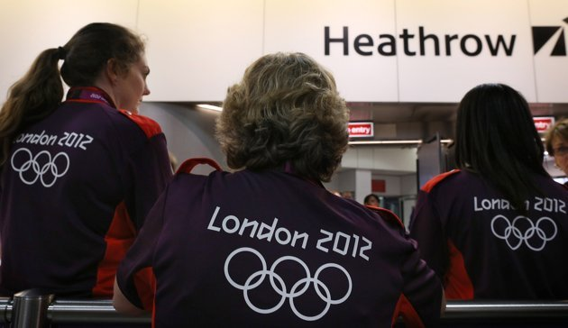 LONDON, ENGLAND - JULY 16: Olympic volunteers wait to greet arriving teams at Heathrow Airport on July 16, 2012 in London, England. Athletes, coaches and Olympic officials are beginning to arrive in L