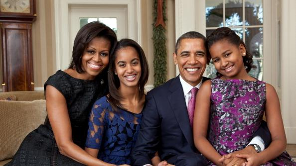 In this handout provided by the White House, (L - R) First Lady Michelle Obama, Malia Obama, U.S. President Barack Obama and Sasha Obama, sit for a family portrait in the Oval Office on December 11, 2011 in Washington, D.C. (Photo by Pete Souza/White House via Getty Images)