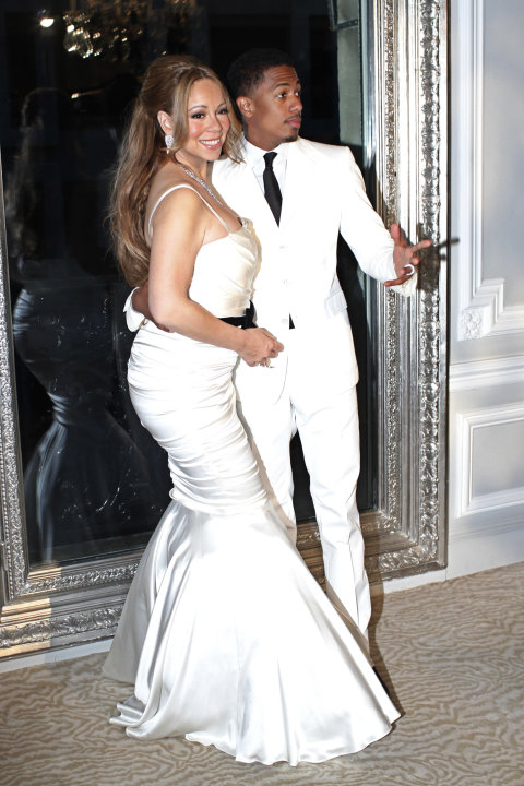 U.S singer Mariah Carey, left, and her husband Nick Cannon pose in Paris, for the renewal of their wedding vows, Friday, April 27, 2012. (AP Photo/Thibault Camus)