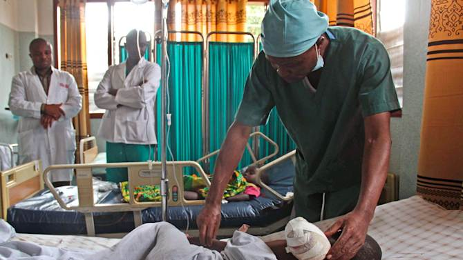 A 12-year-old boy lies in bed at the Heal Africa hospital, after his arm was amputated following a shrapnel wound during heavy fighting between the Congolese army and M23 rebels in Goma, Goma, Congo, Tuesday, Nov. 20, 2012. A rebel group created just seven months ago seized the strategic provincial capital of Goma, home to more than 1 million people in eastern Congo, and its international airport on Tuesday, officials and witnesses said, raising the specter of a regional war. (AP Photo/Melanie Gouby)