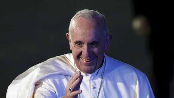 Pope Francis gestures after his arrival in Mexico City