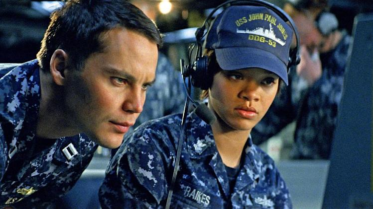 "In this film image provided by Universal Pictures, Taylor Kitsch, left, and Rihanna are shown in a scene from ""Battleship.""  On Saturday, Feb. 23, 2013 at the 33rd Annual Razzie Awards, Rihanna was awarded worst supporting actress for ""Battleship."" (AP Photo/ILM/Universal Pictures)"