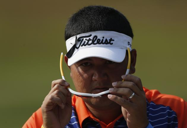 Meesawat of Thailand adjusts glasses during second day of European Tour Hong Kong Open golf tournament