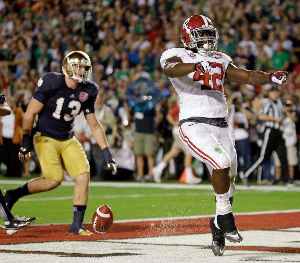Alabama's Eddie Lacy (42) reacts after rushing for a touchdown during the first half of the BCS championship football game against Notre Dame Monday, Jan. 7, 2013, in Miami. (AP Photo/David J. Phillip)